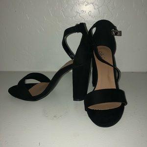 Thick heeled black strap heels